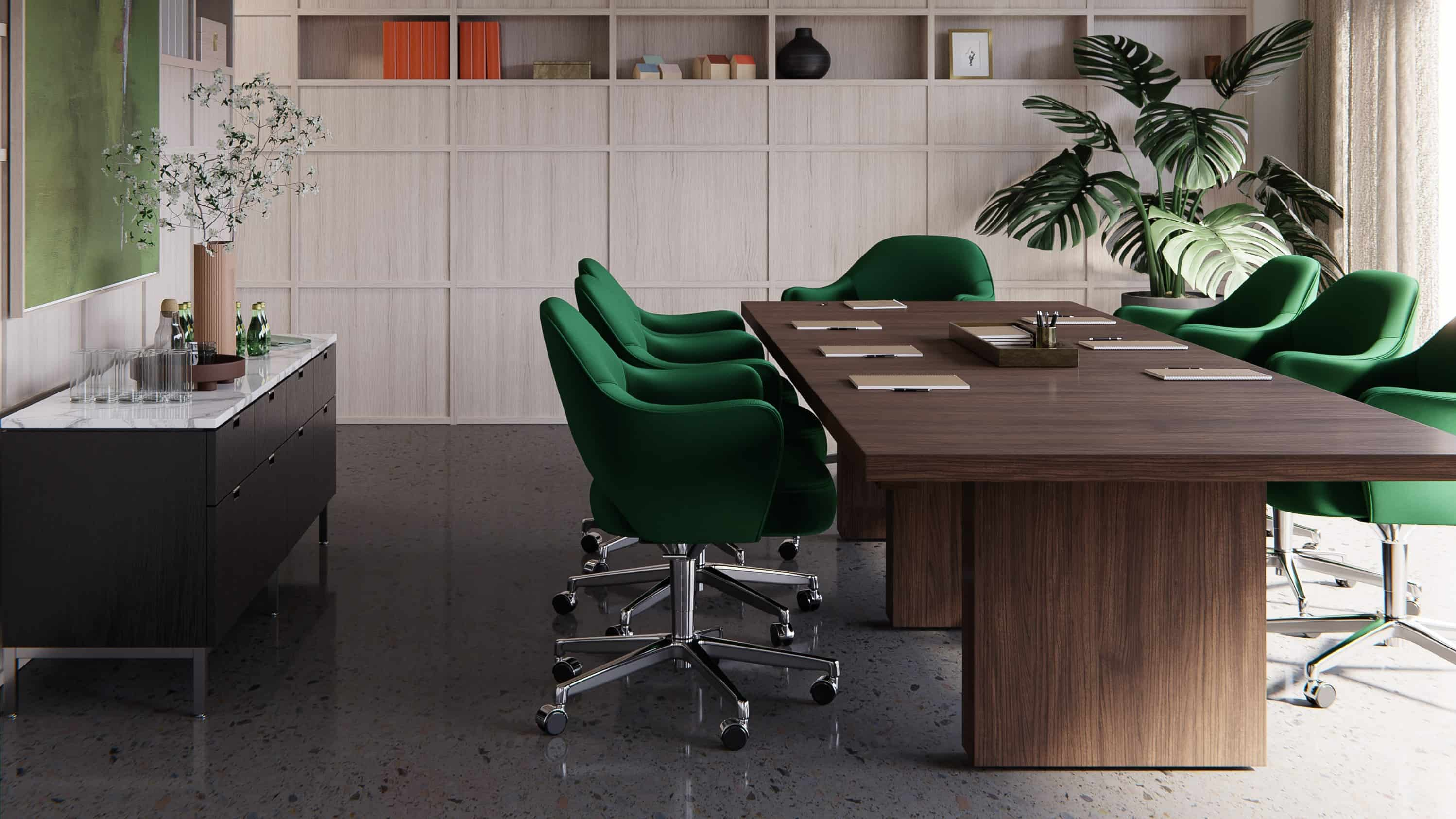 A conference room with wood table and emerald green chairs
