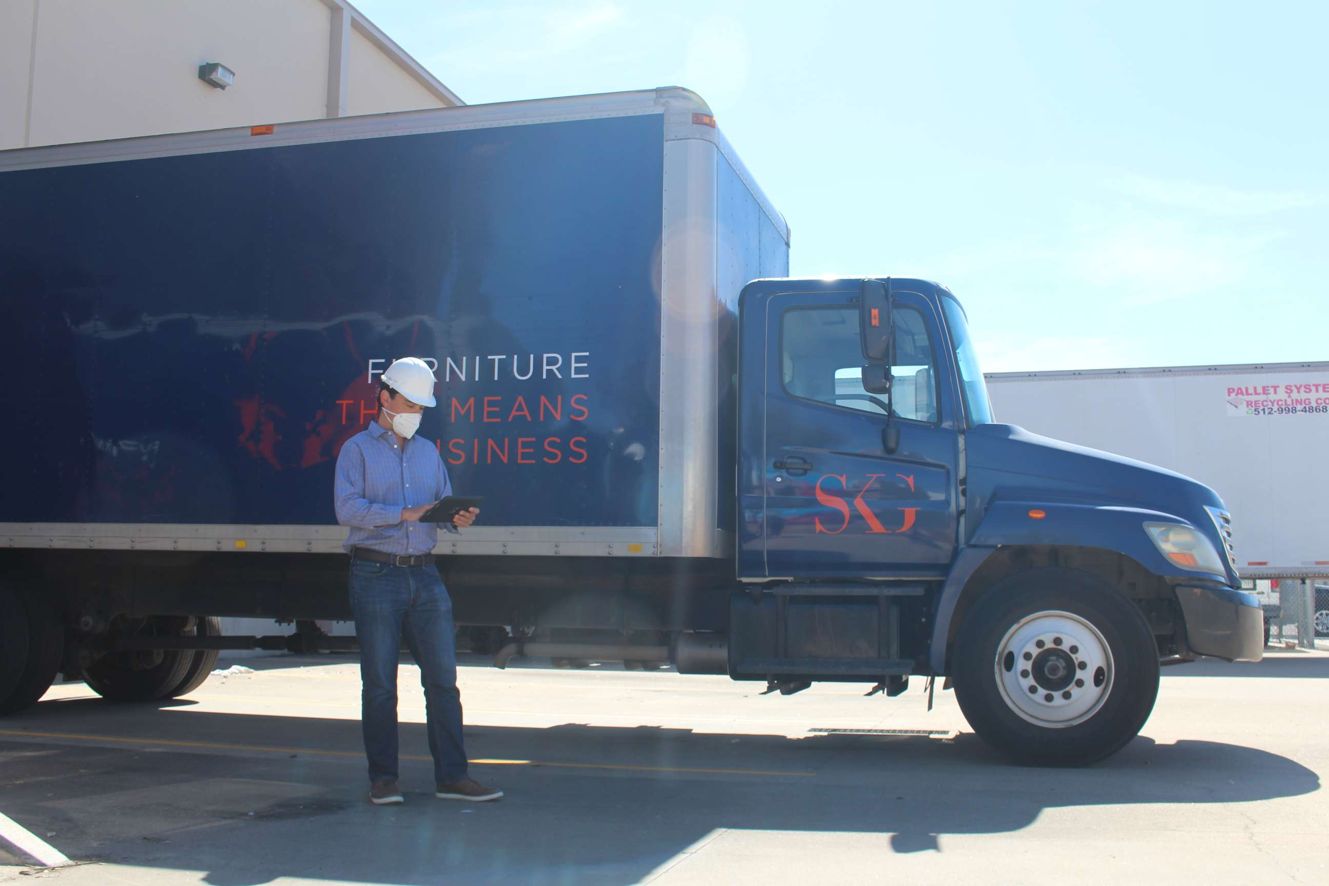 Project manager with SKG truck