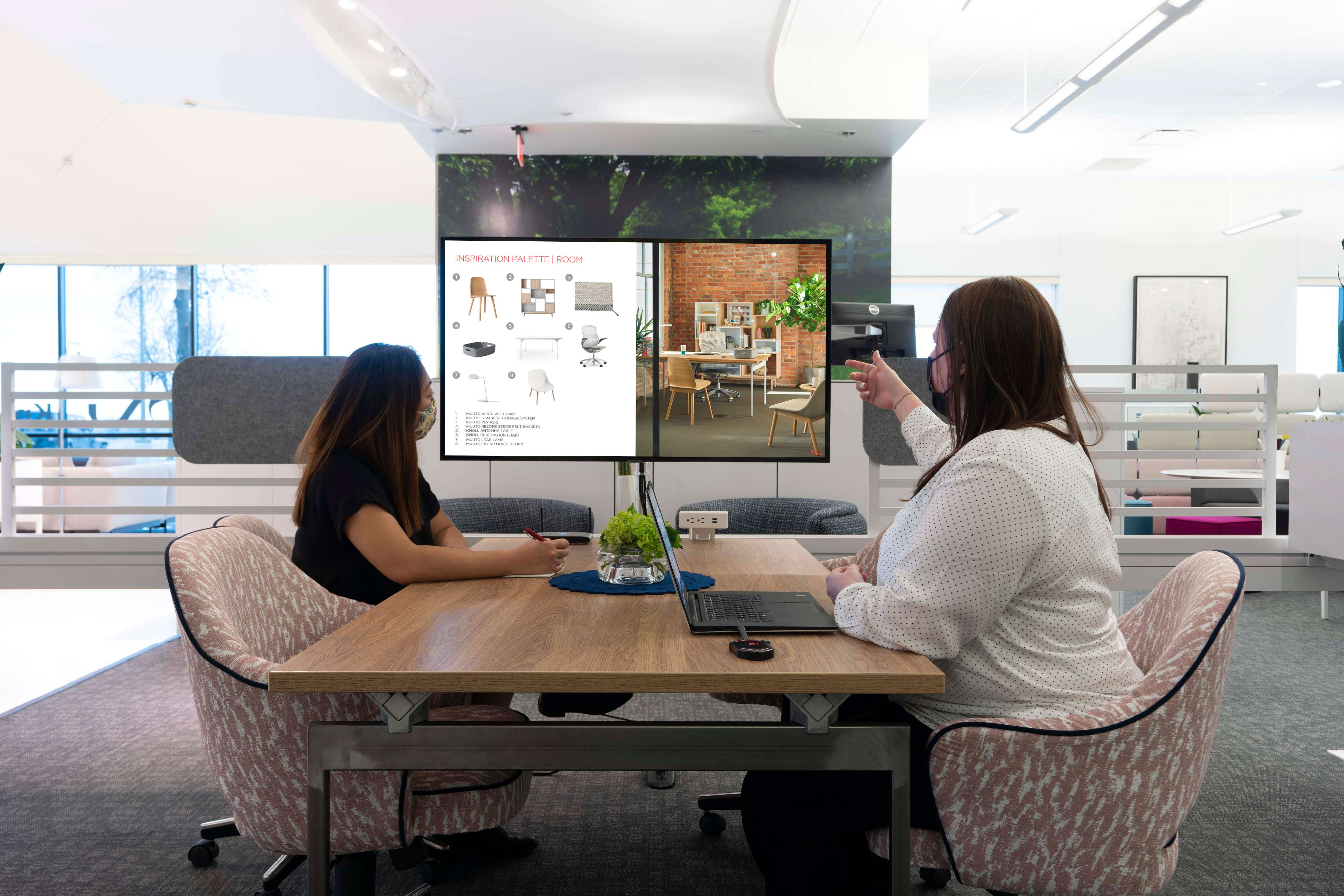 Employees working together using a collaborative space and technology