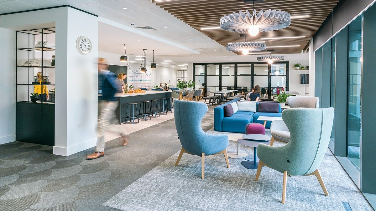 A blue lounge space and cafe with lighting
