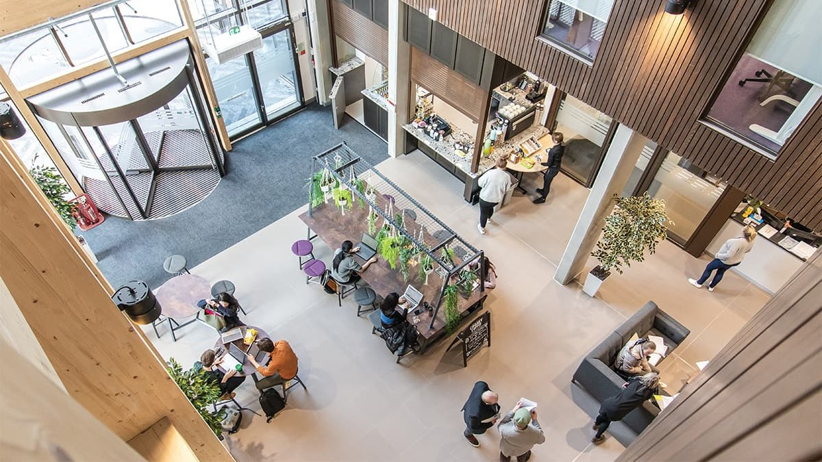 birds eye view of office lobby with tables and chairs