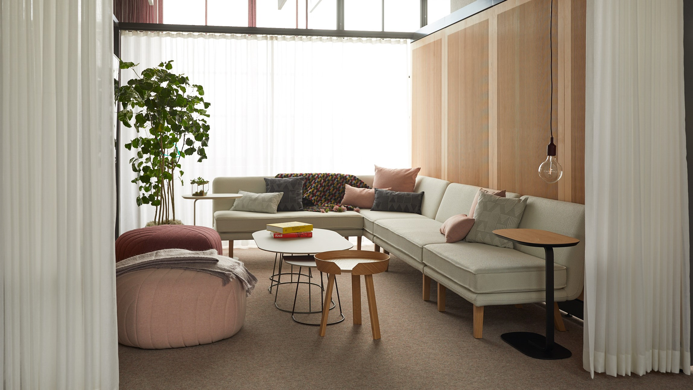 pastel colored room with lounge furniture and freestanding walls with curtains