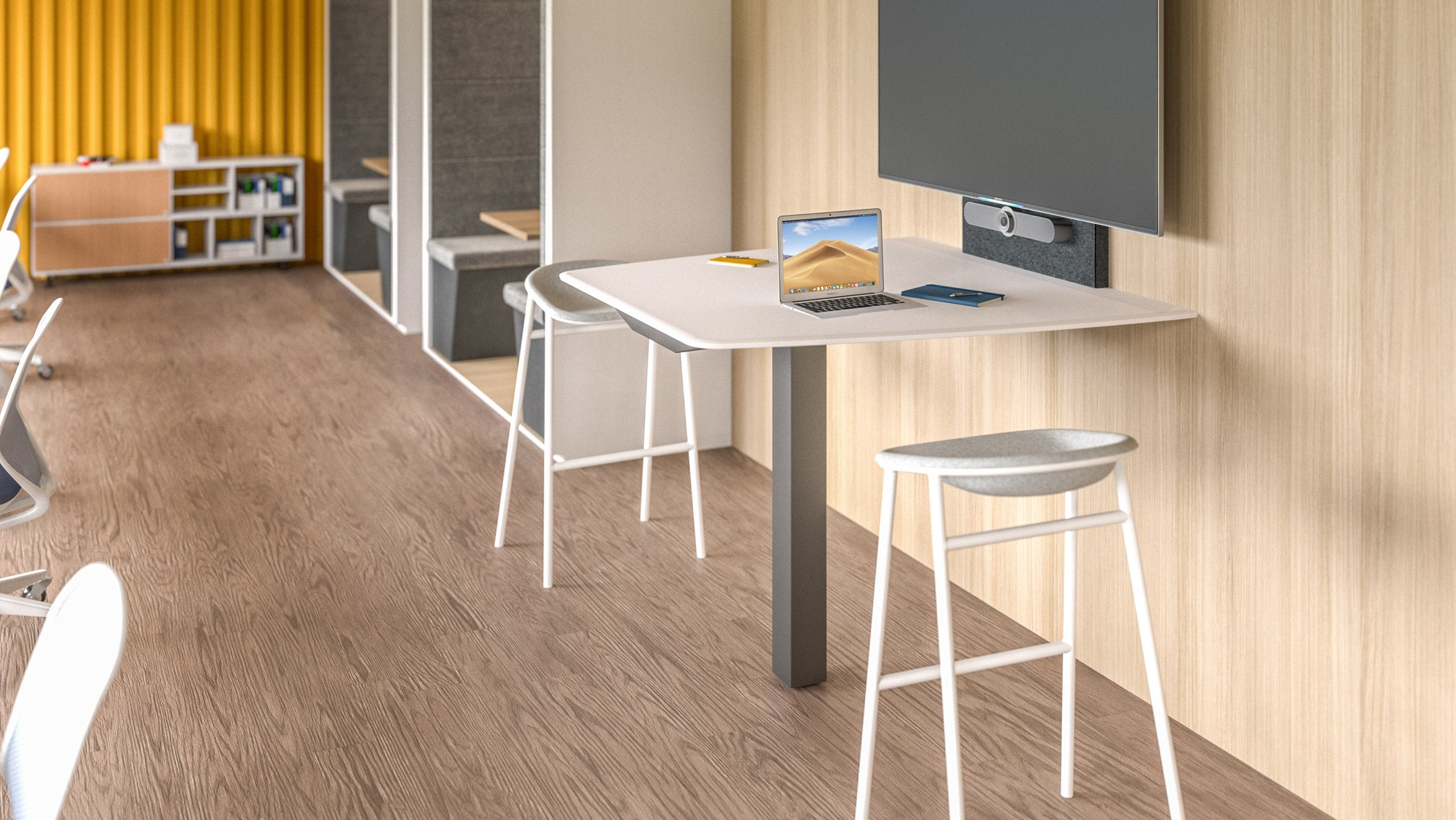 Small meeting table with large display in multi-function area with warm finishes