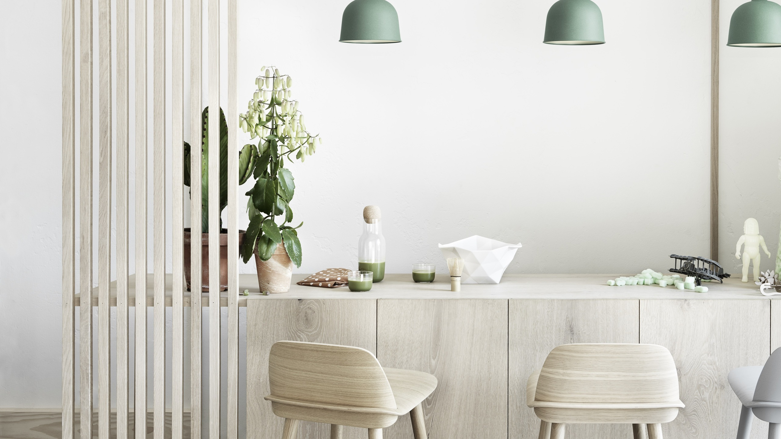 White-painted bar area with stools, pendant lighting and exposed ceiling