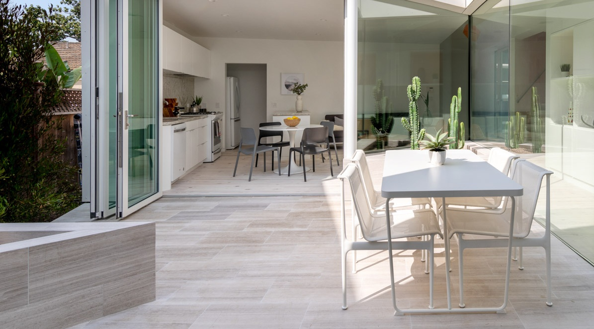 Modern home patio and open kitchen with neutral furniture
